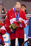 Sochi, RUSSIA - Mar 15 2014 - Benoit St-Amand receives his Bronze medal in Sledge Hockey at the 2014 Paralympic Winter Games in Sochi, Russia.  (Photo: Matthew Murnaghan/Canadian Paralympic Committee)