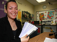 Mission Bay High School student Pamela Villavicencio holds Stockholder Certificates for the tee-shirt company POTO (Put On That Outfit) that she formed with her classmates in the Business 100 course, Friday April 25, 2008