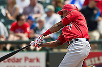 Memphis Redbirds designated hitter Joey Butler #7 swings the bat during the Pacific Coast League baseball game against the Round Rock Express on April 27, 2014 at the Dell Diamond in Round Rock, Texas. The Express defeated the Redbirds 6-2. (Andrew Woolley/Four Seam Images)