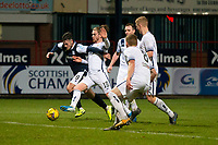 29th December 2020; Dens Park, Dundee, Scotland; Scottish Championship Football, Dundee FC versus Alloa Athletic; Danny Mullen of Dundee bursts past Blair Malcolm of Alloa Athletic