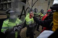 BOGOTA - COLOMBIA, 21-08-2020: Para protestar por los ultimos acontecimientos de asesinatos de jovenes en Cali, Cauca y Nariño, alrededor de unas 200 personas se reunieron en El Centro Nacional de Memoria Historica de Colombia y se movilizaron hacia el centro de Bogota, a los alrededores de la Plaza de Bolivar, terminando en enfrentamientos contra la fuerza disponible de la Policía Nacional. / To protest the latest events in the murder of young people in Cali, Cauca, and Nariño, around 200 people gathered at the National Center for Historical Memory of Colombia and mobilized towards the center of Bogotá, around the Plaza de Bolivar, ending in confrontations against the available force of the National Police. / Photo: VizzorImage / Diego Cuevas / Cont.