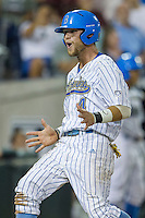 UCLA outfielder Eric Filia (4) screams as he scores a run during Game 12 of the 2013 Men's College World Series against the North Carolina Tar Heels on June 21, 2013 at TD Ameritrade Park in Omaha, Nebraska. The Bruins defeated the Tar Heels 4-1, to reach the CWS Final and eliminate North Carolina from the tournament. (Andrew Woolley/Four Seam Images)