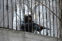 A Berkut riot police man with rifle gear during the   protest against new draconian law to ban the right to  protest across the country.  Kiev. Ukraine