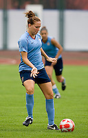 USWNT forward Lauren Cheney takes a touch on the ball during practice at Beijing Normal University in preparation for the Olympic gold medal game at Workers' Stadium in Beijing, China.