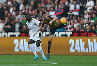 Bafetimbi Gomis of Swansea City and Laurent Koscielny of Arsenal in action during the Barclays Premier League match between Swansea City and Arsenal played at The Liberty Stadium, Swansea on October 31st 2015