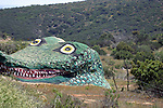 Gigantic alligator sculpture carved into rock <br />