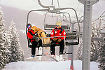 Vail Mountain's Avalanche Rescue Dog, Henry rides the chair lift with his owner, Vail ski patrol supervisor, Chris 'Mongo' Reeder and Vail patrolman  Ben Kurtz.