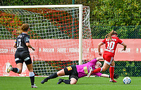 Estelle Loos (14) of Eendracht Aalst attempts to catch the ball from the feet of Davinia Vanmechelen (10) of Standard  during a female soccer game between Standard Femina de Liege and Eendracht Aalst dames on the fourth matchday in the 2021 - 2022 season of the Belgian Scooore Womens Super League , Saturday 11 th of September 2021  in Angleur , Belgium . PHOTO SPORTPIX | BERNARD GILLET