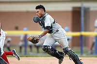 Hudson Valley Renegades catcher Jose Rojas (5) chases a runner in a run down during a game against the Batavia Muckdogs on July 31, 2016 at Dwyer Stadium in Batavia, New York.  Hudson Valley defeated Batavia 4-1.  (Mike Janes/Four Seam Images)
