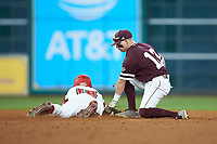 Hunter Stovall (13) of the Mississippi State Bulldogs attempts to tag Hunter Kasuls (19) of the Louisiana Ragin' Cajuns in game three of the 2018 Shriners Hospitals for Children College Classic at Minute Maid Park on March 2, 2018 in Houston, Texas.  The Bulldogs defeated the Ragin' Cajuns 3-1.   (Brian Westerholt/Four Seam Images)
