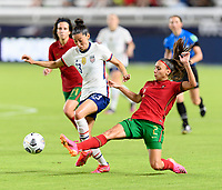 HOUSTON, TX - JUNE 10: Catarina Amado #2 of Portugal strips the ball from Christen Press #23 of the United States during a game between Portugal and USWNT at BBVA Stadium on June 10, 2021 in Houston, Texas.