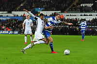 Rhian Brewster of Swansea City battles with Geoff Cameron of Queens Park Rangers during the Sky Bet Championship match between Swansea City and Queens Park Ranger at the Liberty Stadium in Swansea, Wales, UK. Tuesday 11 February 2020