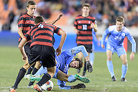 Houston, TX - Friday December 9, 2016: Tucker Hume (26) of the North Carolina Tar Heels battles with Jared Gilbey (15) of the Stanford Cardinal for the ball  at the NCAA Men's Soccer Semifinals at BBVA Compass Stadium in Houston Texas.