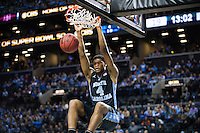 BROOKLYN, NY - Saturday December 19, 2015: Isaiah Hicks (#4) of North Carolina dunks on UCLA as the two square off in the CBS Classic at Barclays Center in Brooklyn, NY.