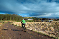 A cyclist cycling around Neilston Pad, Neilston, East Renfrewshire