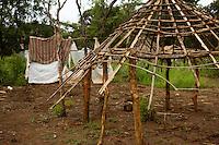 Congolese refugee home under construction in Makpandu camp, South Sudan.