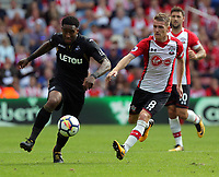 (L-R) Leroy Fer of Swansea City challenged by Steven Davis of Southampton during the Premier League match between Southampton and Swansea City at the St Mary's Stadium, Southampton, England, UK. Saturday 12 August 2017