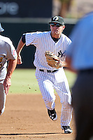 Phoenix Solar Sox second baseman Corban Joseph #18 chases down a base runner during an Arizona Fall League game against the Mesa Solar Sox at Phoenix Municipal Stadium on October 31, 2011 in Phoenix, Arizona.  Mesa defeated Phoenix 3-1.  (Mike Janes/Four Seam Images)