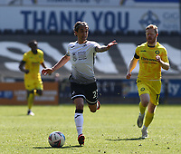 17th April 2021; Liberty Stadium, Swansea, Glamorgan, Wales; English Football League Championship Football, Swansea City versus Wycombe Wanderers; Yan Dhanda of Swansea City directs the play as he runs with the ball