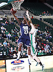 Jackson State Tigers guard De'Suan Dixon (23) does a lay up around North Texas Mean Green center Ben Knox (15) in the game between the Jackson State Tigers and the University of North Texas Mean Green at the North Texas Coliseum,the Super Pit, in Denton, Texas. UNT defeated Jackson 68 to 49