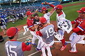 Nolan Gorman (9) of Sandra Day O'Connor High School in Glendale, Arizona is mobbed by teammates including Matthew Liberatore (32), Bobby Witt, Jr. (15), and Matt Rudis (19) after winning the home run derby before the Under Armour All-American Game presented by Baseball Factory on July 29, 2017 at Wrigley Field in Chicago, Illinois.  (Mike Janes/Four Seam Images)