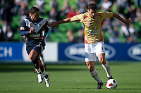 MELBOURNE, AUSTRALIA - DECEMBER 27: Adam D'Apuzzo of the Jets runs with the ball during the round 20 A-League match between the Melbourne Victory and the Newcastle Jets at AAMI Park on December 27, 2010 in Melbourne, Australia. (Photo by Sydney Low / Asterisk Images)
