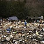 On March 11, 2011, earthquake of magnitude 9.0 and devastating tsunami hit the Tohoku area, killing more than 15,000 people and missing more than 5,000 people. A police stands in the middle of debries where there were houses before tsunami swallowed the houses in Unosumai district in Kamaishi, Iwate.<br /> <br /> Le 11 mars 2011, un séisme de magnitude 9,0 et un tsunami dévastateur ont frappé la région de Tohoku, faisant plus de 15 000 morts et plus de 5 000 disparus. Une police se tient au milieu de rues où il y avait des maisons avant que le tsunami n'engloutisse les maisons du district d'Unosumai à Kamaishi, Iwate.