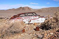 1947 Buick Roadmaster lies abandoned and rusting near Harrisburg and the Eureka Mine in Death Valley National Park.