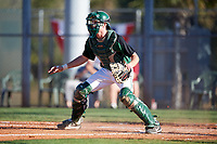 Dartmouth Big Green catcher Bennett McCaskill (18) waits for a throw before it getting cut off during a game against the Northeastern Huskies on March 3, 2018 at North Charlotte Regional Park in Port Charlotte, Florida.  Northeastern defeated Dartmouth 10-8.  (Mike Janes/Four Seam Images)