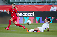 CARSON, CA - FEBRUARY 07: Janine Beckie #16 of Canada crosses a ball past a sliding Costa Rican during a game between Canada and Costa Rica at Dignity Health Sports Park on February 07, 2020 in Carson, California.