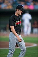 Great Falls Voyagers starting pitcher Jason Bilous (14) walks off the field between innings of a Pioneer League game against the Idaho Falls Chukars at Melaleuca Field on August 18, 2018 in Idaho Falls, Idaho. The Idaho Falls Chukars defeated the Great Falls Voyagers by a score of 6-5. (Zachary Lucy/Four Seam Images)