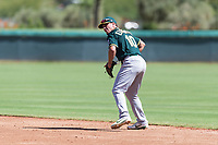 Oakland Athletics second baseman Jeremy Eierman (10) prepares to throw to first base during an Instructional League game against the Los Angeles Dodgers at Camelback Ranch on September 27, 2018 in Glendale, Arizona. (Zachary Lucy/Four Seam Images)