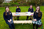 Students enjoying their new outdoor benches in the Tralee Presentation Secondary school on Friday. L to r: Shauna Moriarty, Akram Ghomeid, Emer Moriarty and Ellen Fitzmaurice.