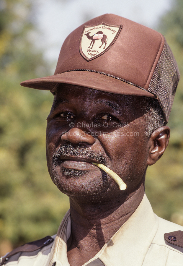 Nigerien American Embassy Security Guard with Chewing Stick for Cleaning Teeth, Niamey, Niger.