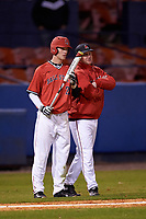 Ball State Cardinals left fielder CJ Alexander (20) talks with head coach Rich Maloney (right) during a game against the Wisconsin-Milwaukee Panthers on February 26, 2016 at Chain of Lakes Stadium in Winter Haven, Florida.  Ball State defeated Wisconsin-Milwaukee 11-5.  (Mike Janes/Four Seam Images)