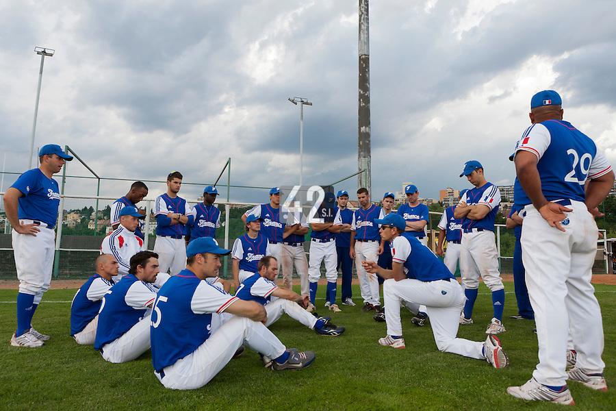 22 June 2011: Team France manager Fabien Proust talks to his players after AIST Alumni 5-3 win over France, at the 2011 Prague Baseball Week, in Prague, Czech Republic.