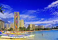 After a race, outrigger canoes line up on a section of Waikiki Beach in front of the Hilton Hawaiian Village hotel's Rainbow Tower.