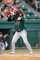 Second baseman Andres Alvarez (7) of the Greensboro Grasshoppers in a game against the Greenville Drive on Thursday, July 22, 2021, at Fluor Field at the West End in Greenville, South Carolina. (Tom Priddy/Four Seam Images)