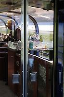 Michael Devitt  staffs the refreshments area on the Alaska Railroad's Goldstar first-class railcar.