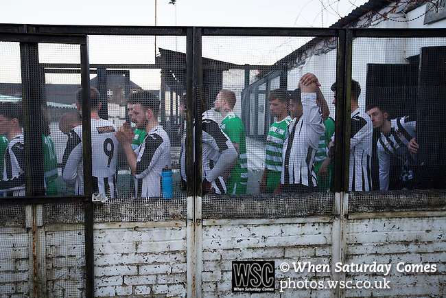 Bacup Borough 4 Holker Old Boys 1, 25/04/2016. Brain Boys West View Stadium, NorthWest Counties League Division One. The two teams waiting outside the dressing rooms at the Brain Boys West View Stadium before Bacup Borough (in black) play Holker Old Boys in a NorthWest Counties League division one fixture. Formed as Bacup in 1879, the club moved into their current home in 1889 and have been known as Bacup Borough since the 1920s, apart from a brief recent spell when they added the name Rossendale to their name. With both teams challenging for play-off places, Bacup Borough won this fixture by 4-1, watched by a crowd of 50. Photo by Colin McPherson.