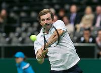 11-02-14, Netherlands,Rotterdam,Ahoy, ABNAMROWTT,  JulienBenneteau (FRA)  in his match against Jerzy Janowicz (POL)<br /> Photo:Tennisimages/Henk Koster