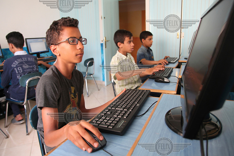 Children using computers at the Dar Al Atfal Al Wafae (Forsaken children) a home for abandoned children.