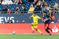 FOXBOROUGH, MA - AUGUST 4: Taylor Washington #23 of Nashville SC dribbles as Brando Bye #15 of New England Revolution defends during a game between Nashville SC and New England Revolution at Gillette Stadium on August 4, 2021 in Foxborough, Massachusetts.