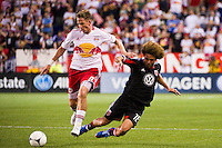 Jan Gunnar Solli (8) of the New York Red Bulls and Nick DeLeon (18) of DC United. The New York Red Bulls defeated DC United 3-2 during a Major League Soccer (MLS) match at Red Bull Arena in Harrison, NJ, on June 24, 2012.