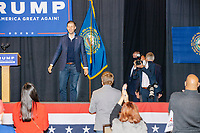 Eric Trump, son of US president Donald Trump, enters the stage to speak during a Make America Great Again! campaign rally at the DoubleTree by Hilton Manchester Downtown in Manchester, New Hampshire, on Mon., Oct. 19, 2020. The audience chairs are distanced to follow safety protocols during the ongoing Coronavirus (COVID-19) global pandemic, just a few weeks after Donald Trump himself contracted the disease, though many other Trump campaign events are lax about COVID safety protocols.