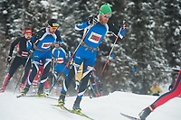 8511<br /> <br /> Tour of Anchorage 50k winner Jack Novak (2001) skis in a pack early in the race Sunday, March 4, 2018.  Photo by Michael Dinneen Photography