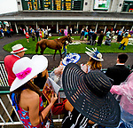 LOUISVILLE, KY - MAY 05: Women dressed in their Derby finest look over the paddock on Kentucky Derby Day at Churchill Downs on May 5, 2018 in Louisville, Kentucky. (Photo by Scott Serio/Eclipse Sportswire/Getty Images)