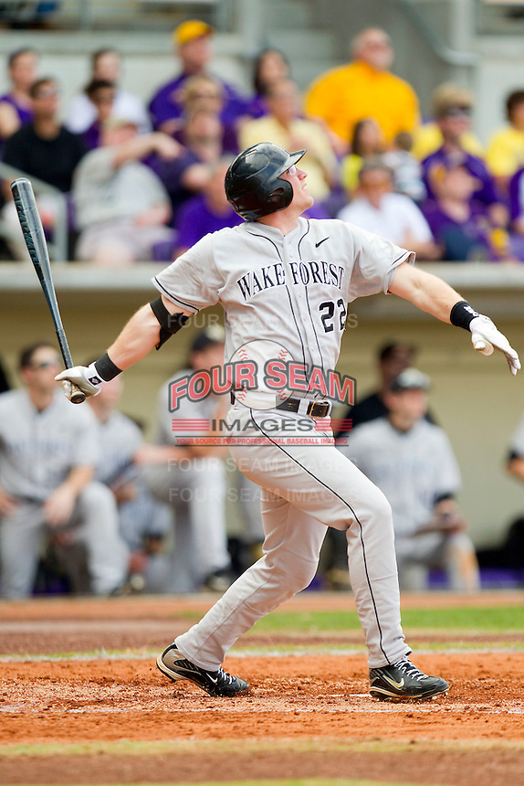 James Harris #22 of the Wake Forest Demon Deacons follows through on his swing against the LSU Tigers at Alex Box Stadium on February 19, 2011 in Baton Rouge, Louisiana.  The Tigers defeated the Demon Deacons 4-3.  Photo by Brian Westerholt / Four Seam Images