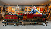BNPS.co.uk (01202 558833)<br /> Pic: MaxWillcock/BNPS<br /> <br /> Pictured: Dreweatts Specialist Martyn Pring inspects a 10 1/4 inch gauge model of the London Midland and Scottish tender locomotive No 6100 'Royal Scott, built from Bassett-Lowke castings and rebuilt by William Whiteley of Newark on Trent at D. Arundel & Co 1972, in the Dreweatts Donnington Priory saleroom.<br /> <br /> A remarkably detailed, functioning model steam engine is tipped to sell for £50,000 after attracting worldwide interest from train enthusiasts.<br /> <br /> The maroon 10.25ins gauge model of the London Midland and Scottish tender locomotive No 6100 'Royal Scott' was built in Bedfordshire in 1965.<br /> <br /> It underwent a significant restoration in 1972 and is still in a 'high quality' condition half a century later.<br /> <br /> The 8ft long locomotive weighs one tonne and has a steel boiler, a coal compartment, brakes, fitted steps, handrails and railway lamps.