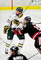 26 November 2010: University of Vermont Catamount forward Matt White, a Freshman from McMurray, PA, is checked by Northeastern University Huskies' forward Steve Silva, a Senior from Tyngsboro, MA, at Gutterson Fieldhouse in Burlington, Vermont. The Huskies came back from a 2-0 deficit to earn a 2-2 tie against the Catamounts. Mandatory Credit: Ed Wolfstein Photo